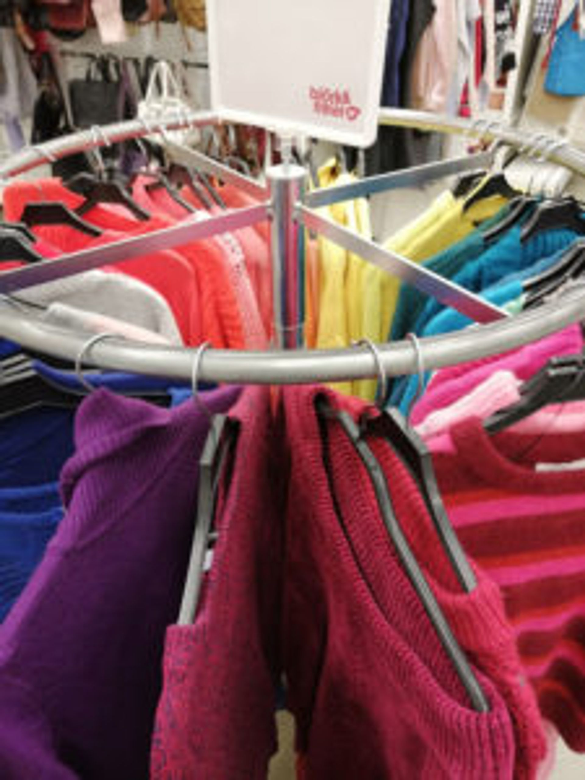 Rack of colourful sweaters at Emmaus Borås