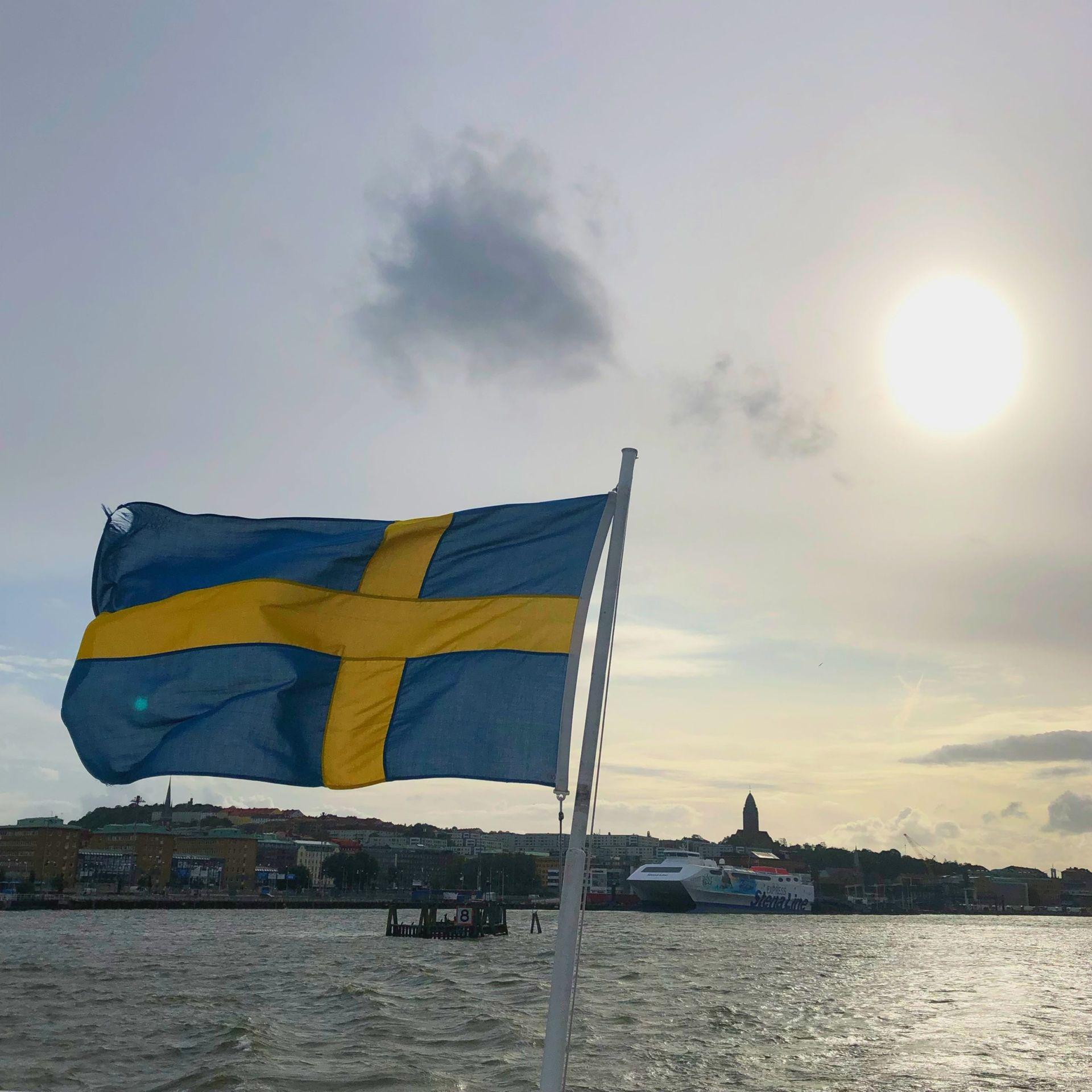A Swedish flag on a boat.
