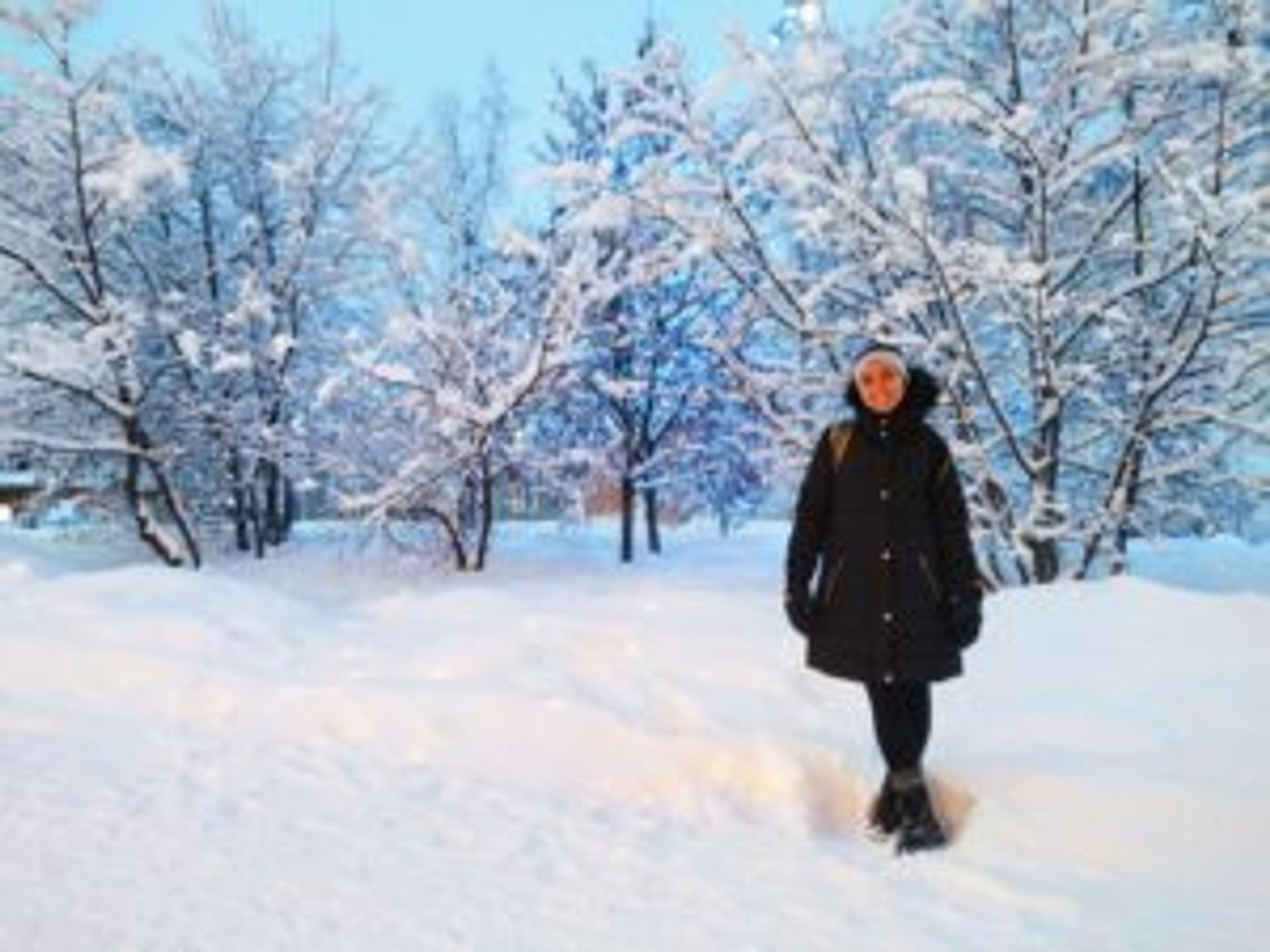 Maria standing in a snowy park.