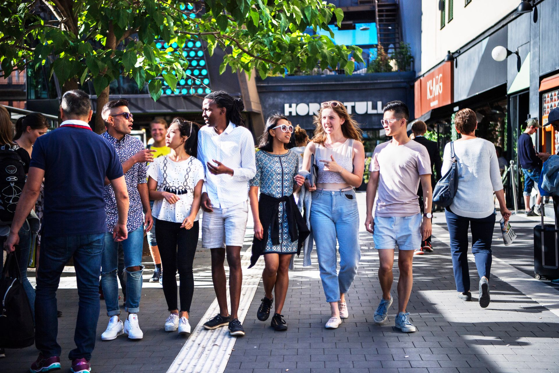 Group of international students walking along a shopping street in Stockholm.