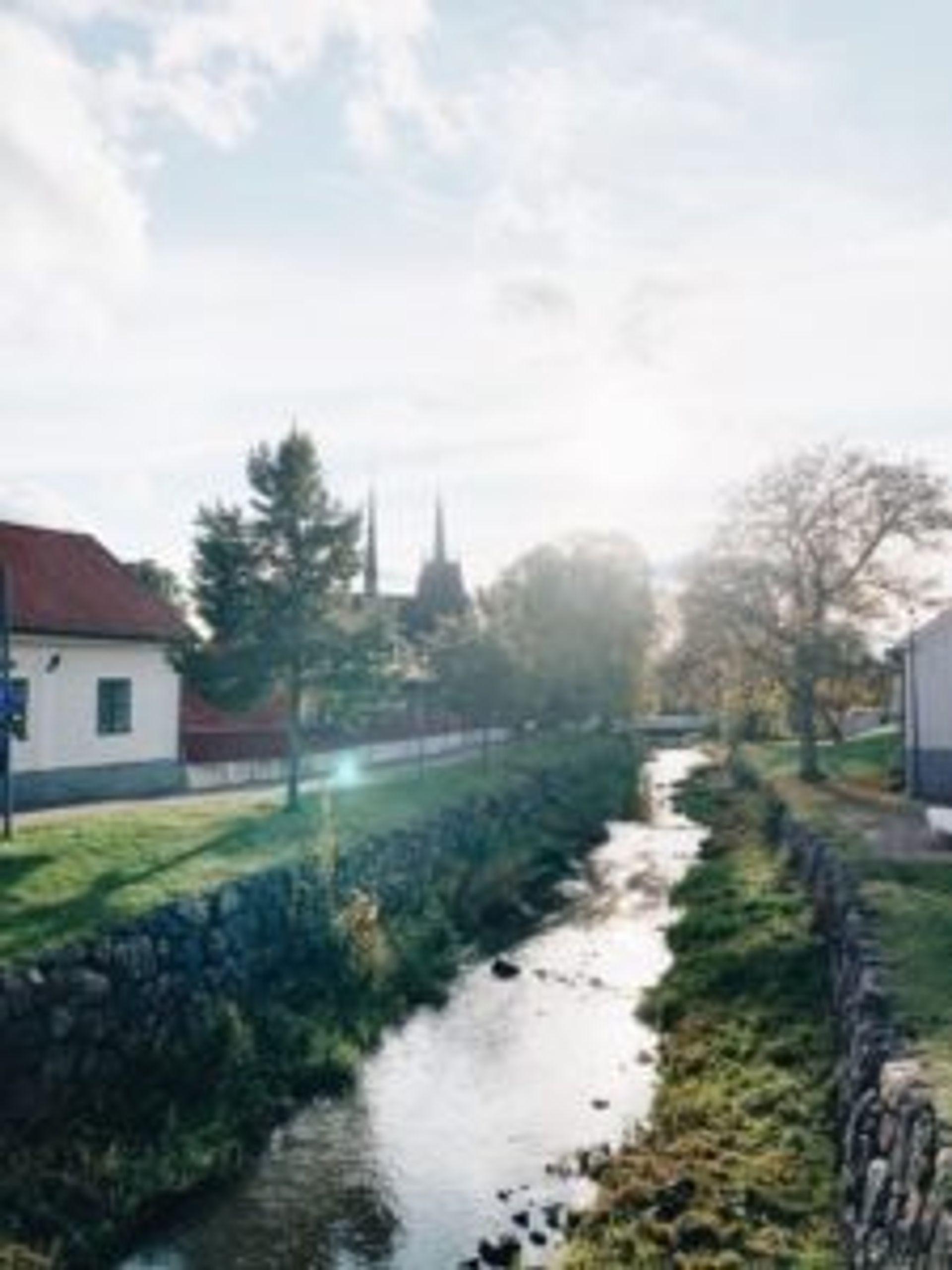 A stream beside a church.