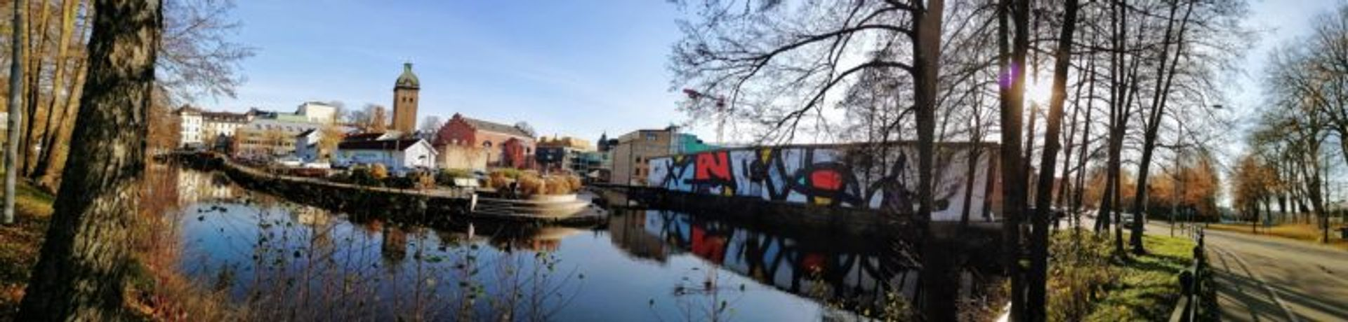 Panoramic view of Borås cityscape with colourful abstract mural by JM Rizzi.