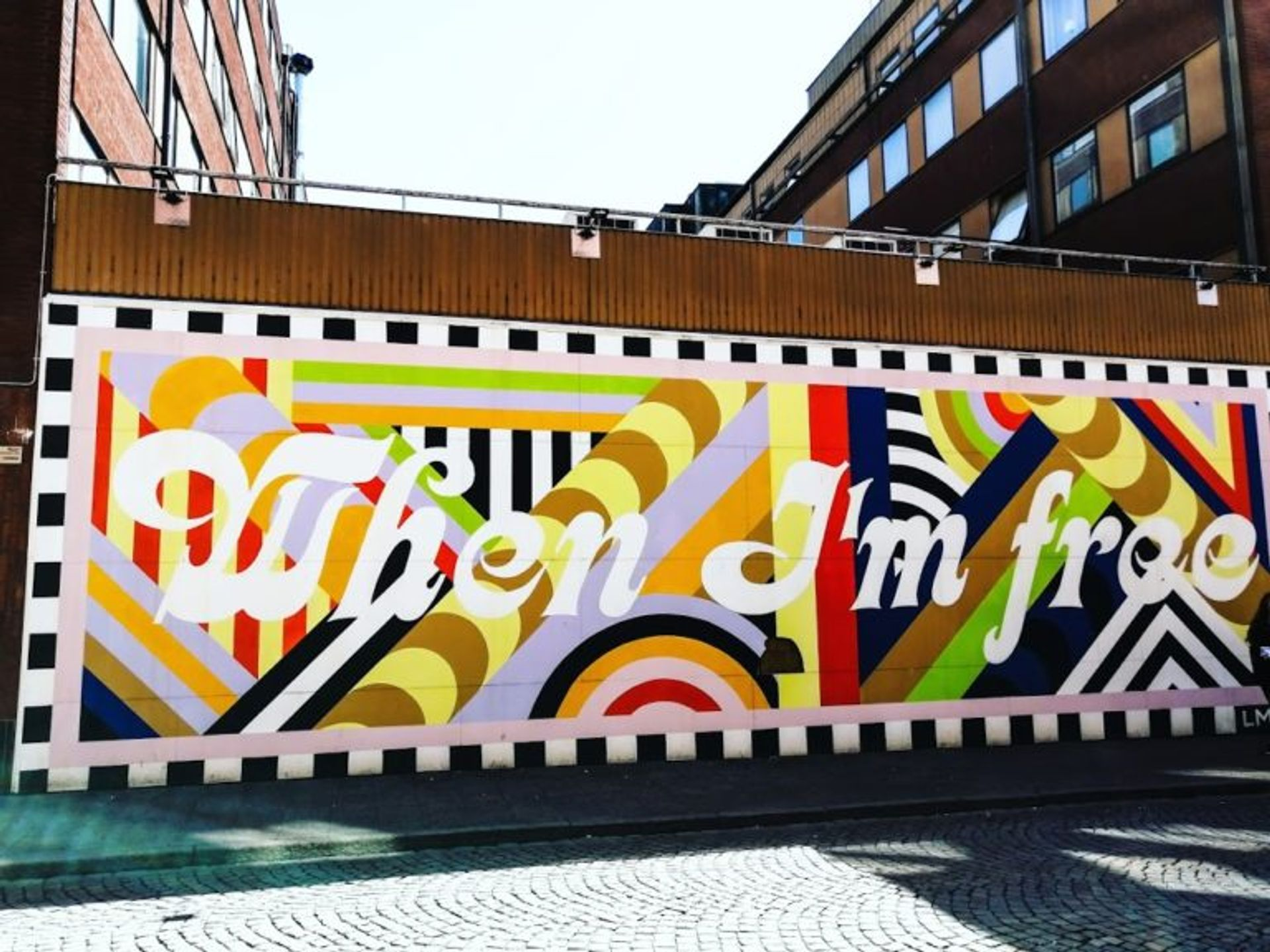 Boldly coloured mural with text 'When I'm free'.