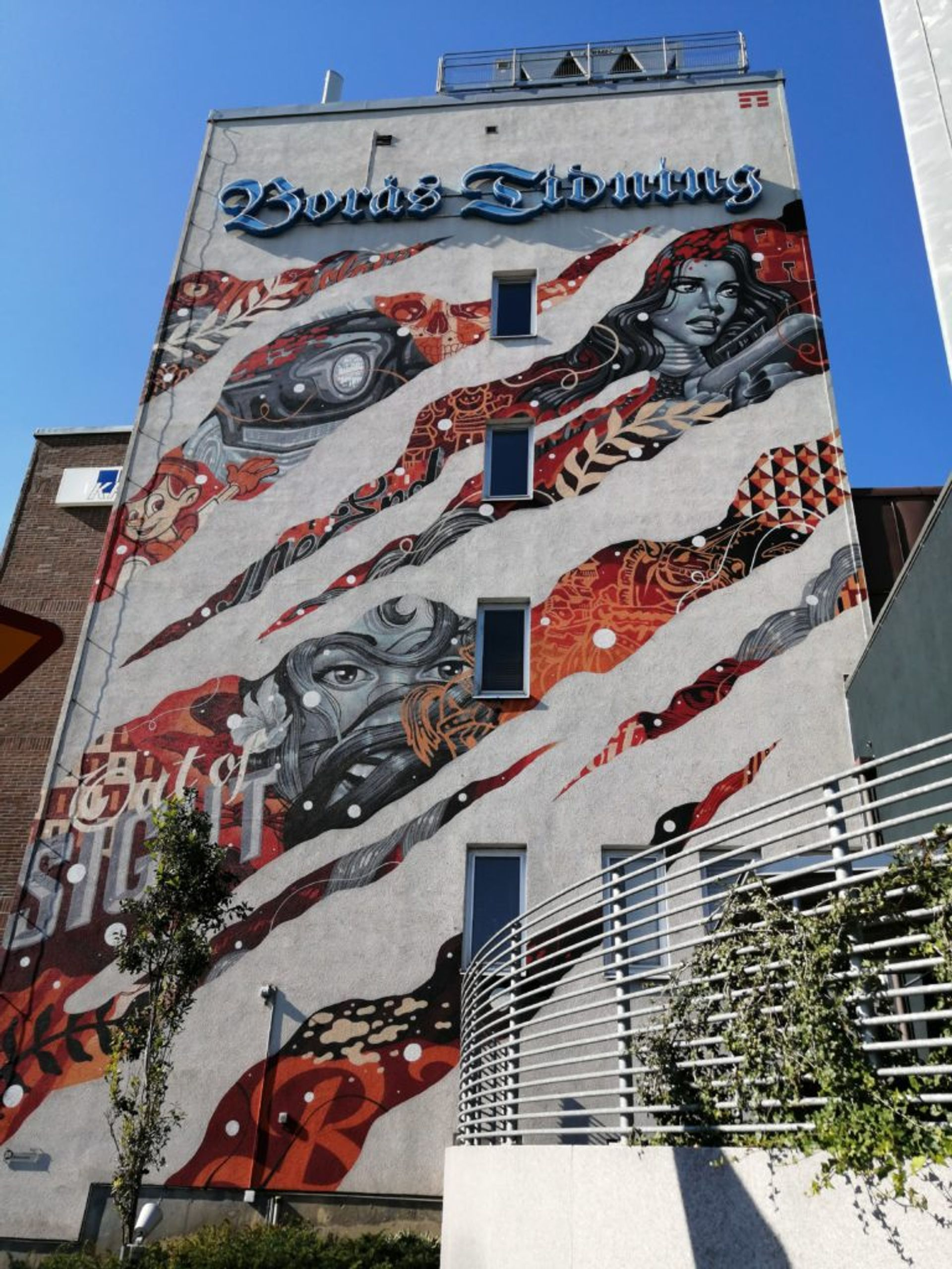 Graphic comic book inspired mural on the side of the Borås newspaper office building.