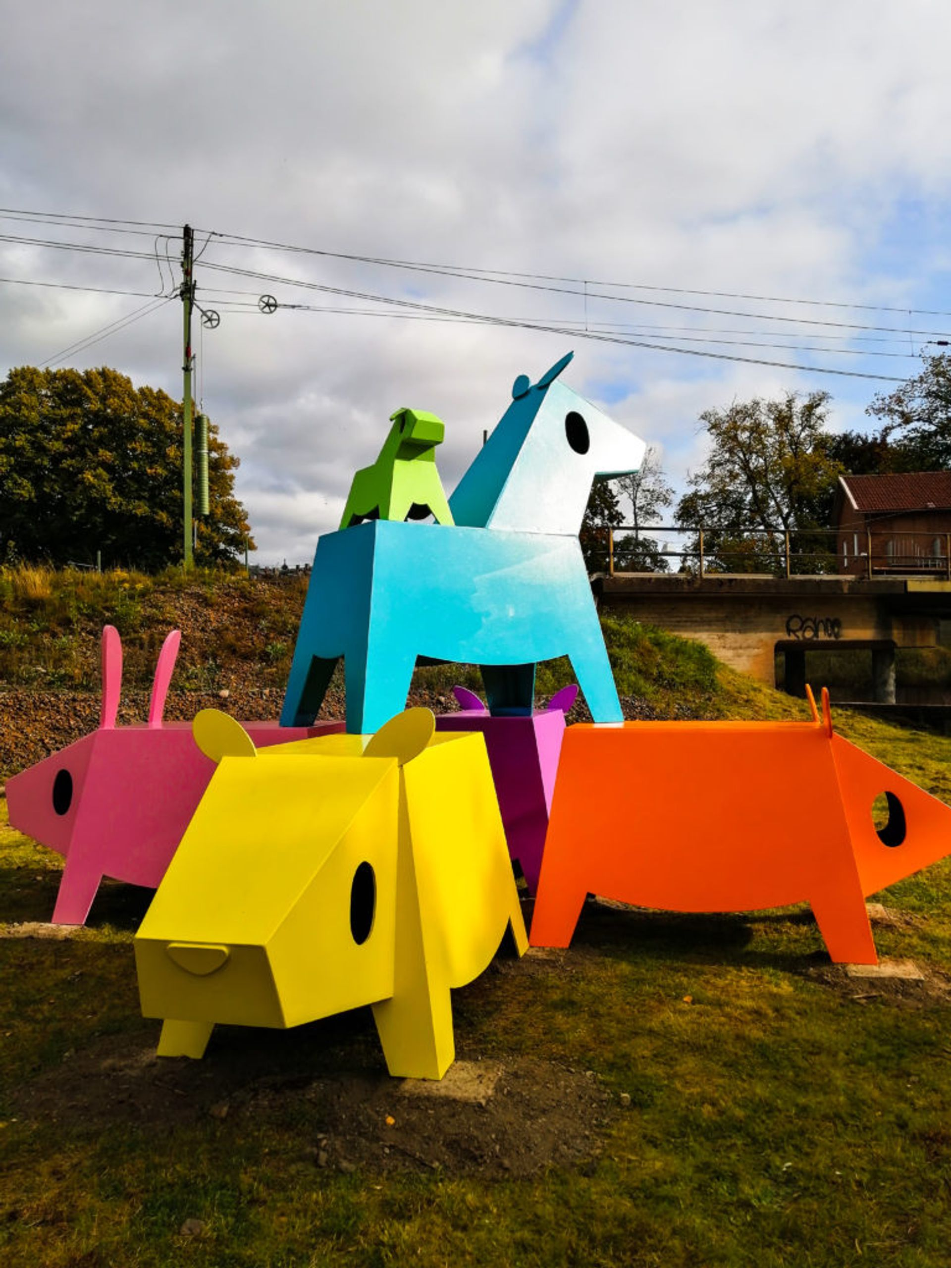 Colourful and childlike sculptures of mammals.