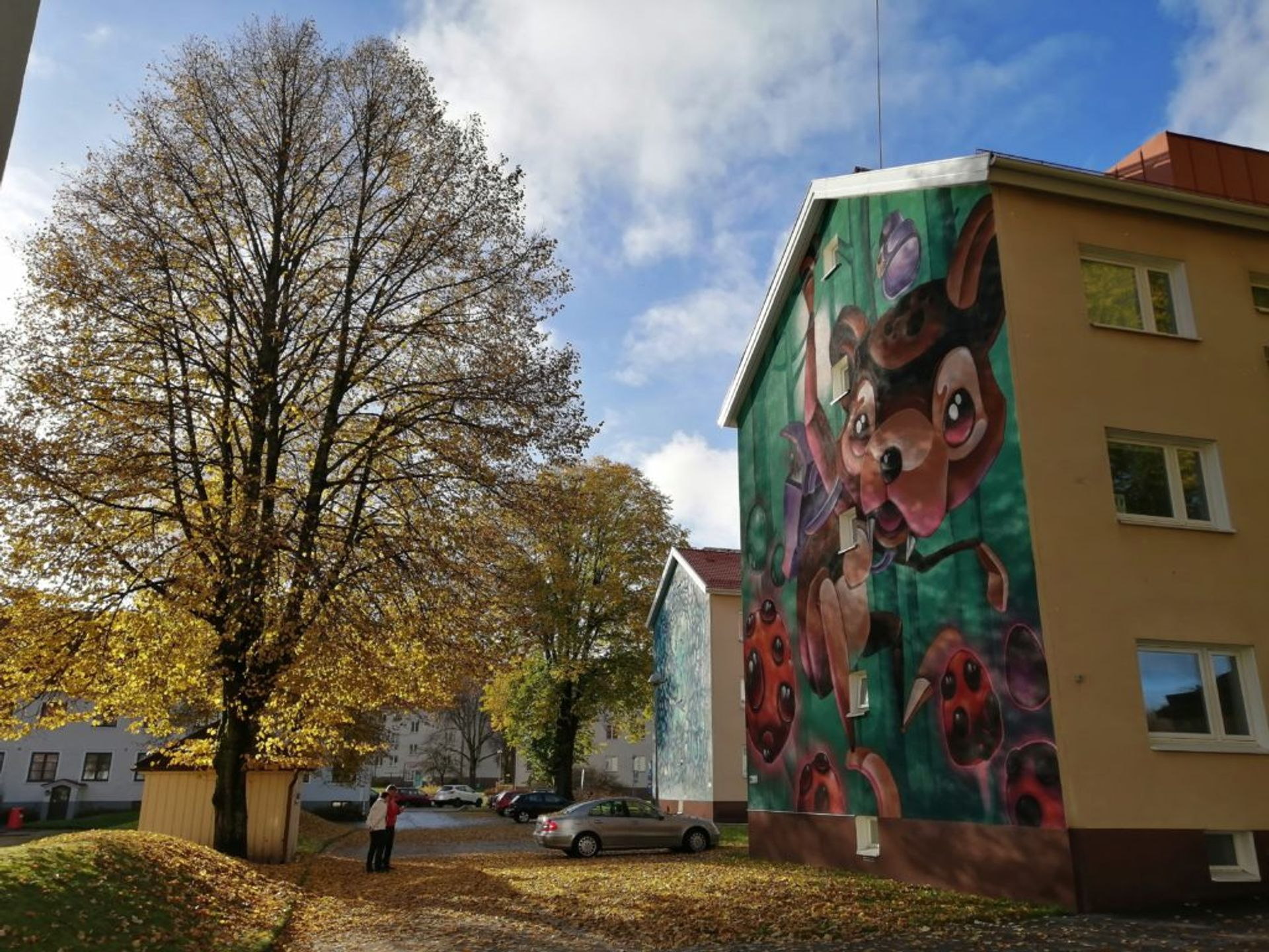 Mural in golden autumn landscape in Norrby suburb.