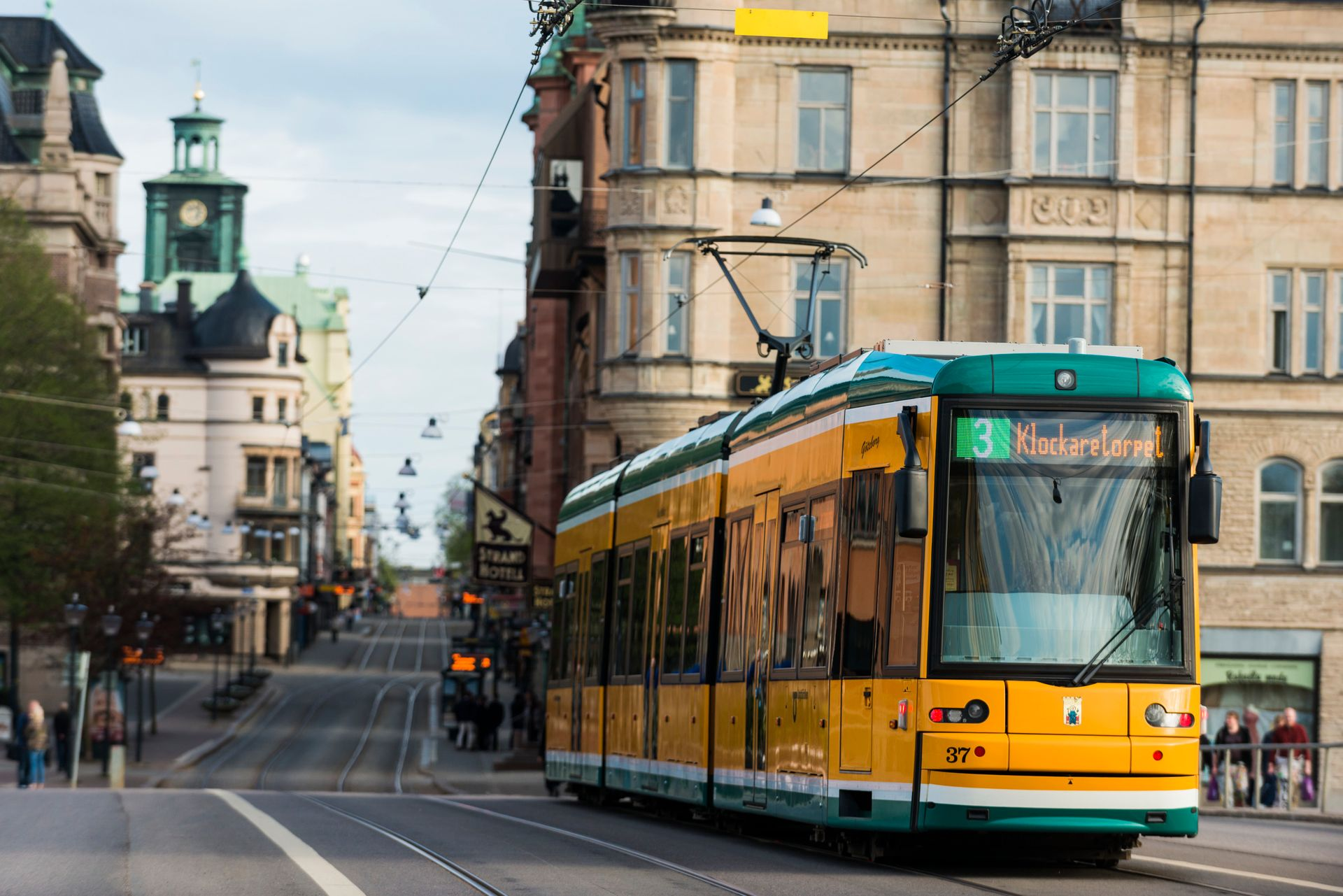 A green and yellow tram.