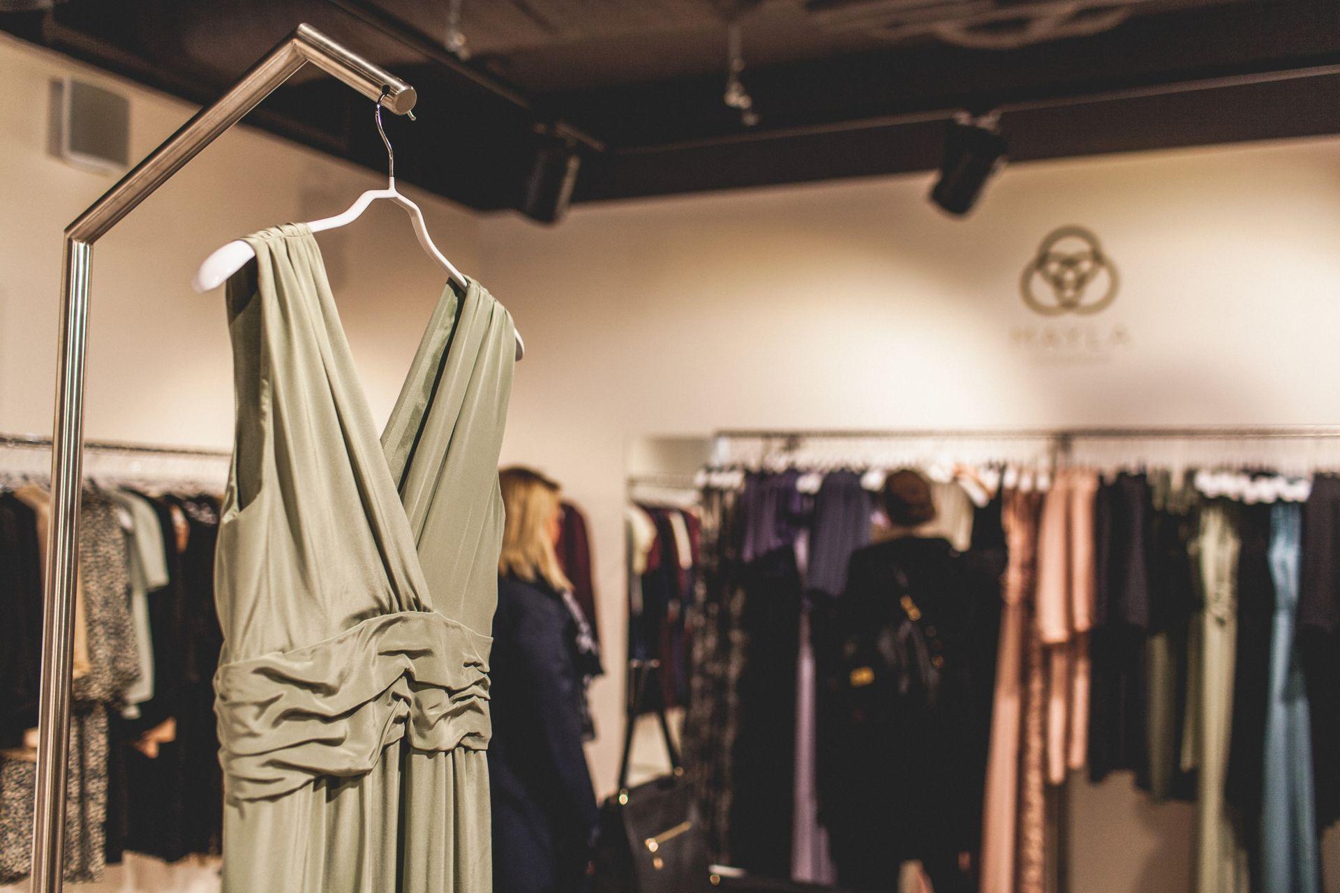 Racks of women's clothing in a designer store.