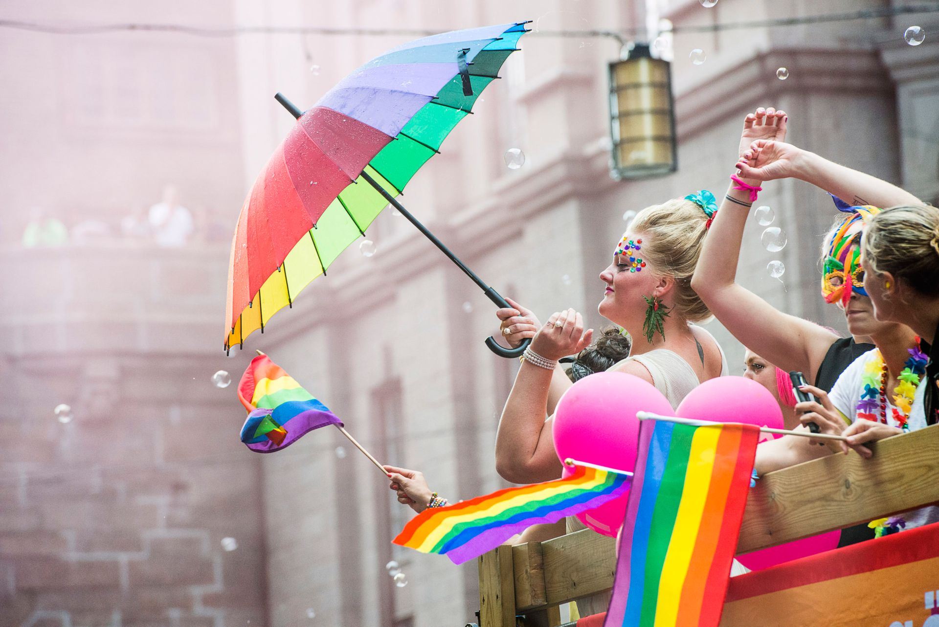 Person touts rainbow umbrella at Pride Festival in Stockholm