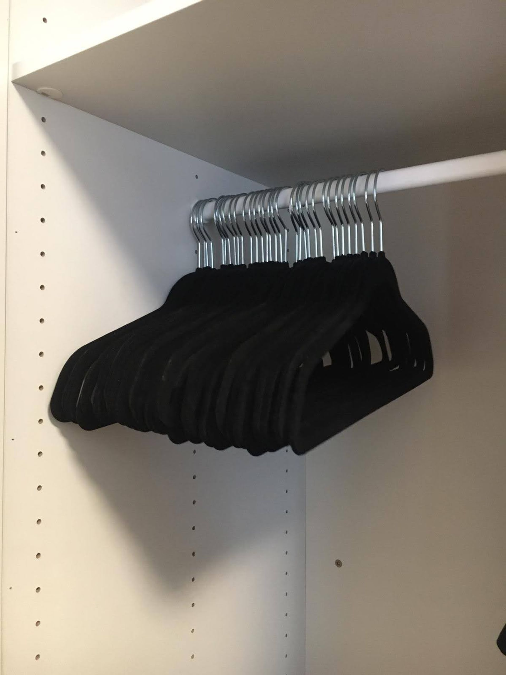 Clothing hangers on a clothing rail