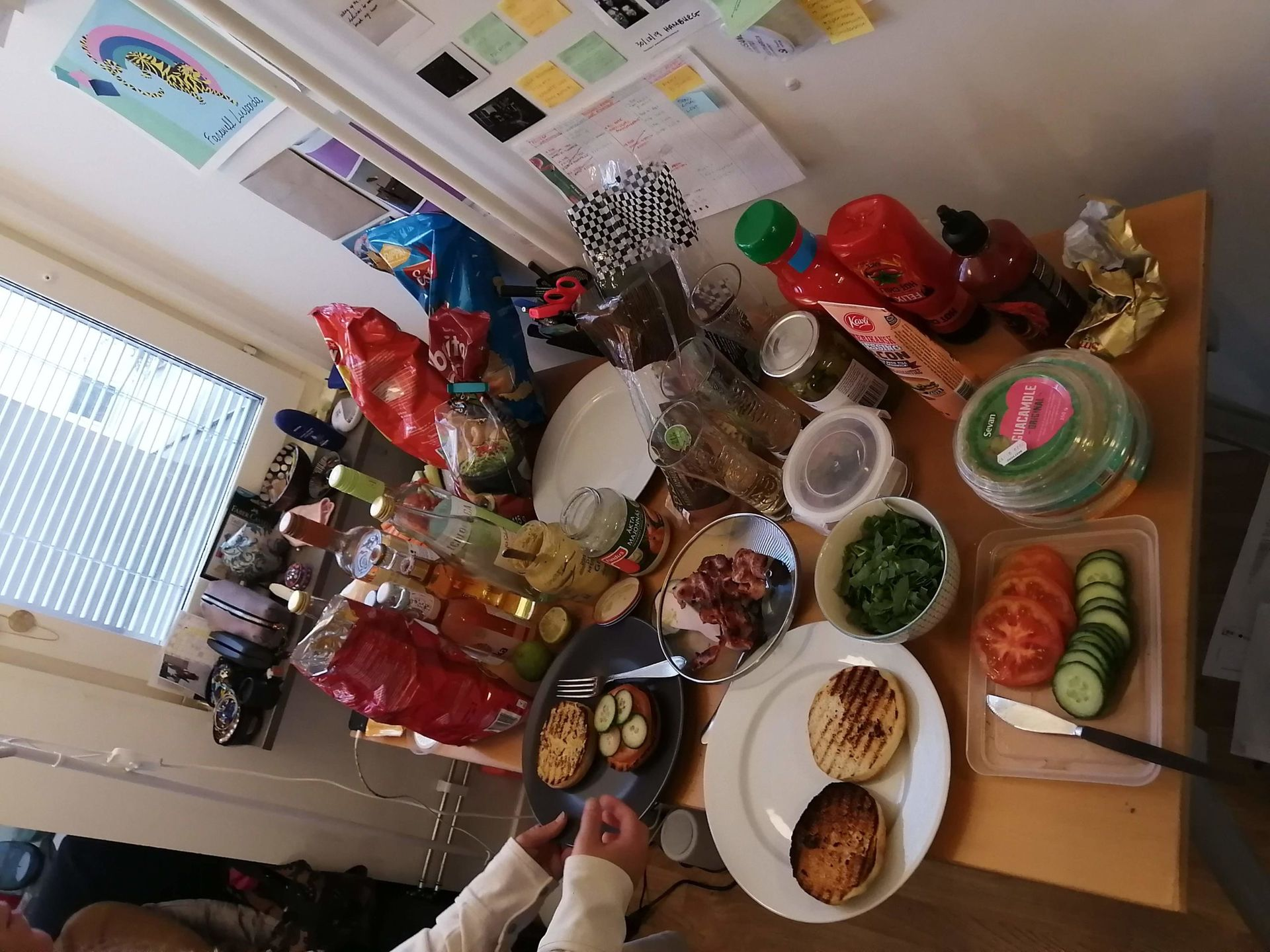 A desk filled with plates of food