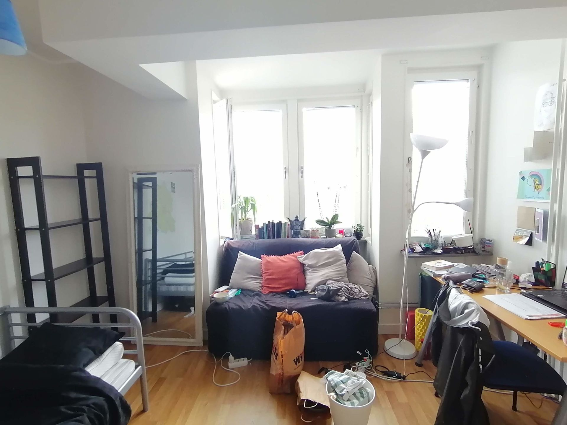 A cluttered studio apartment