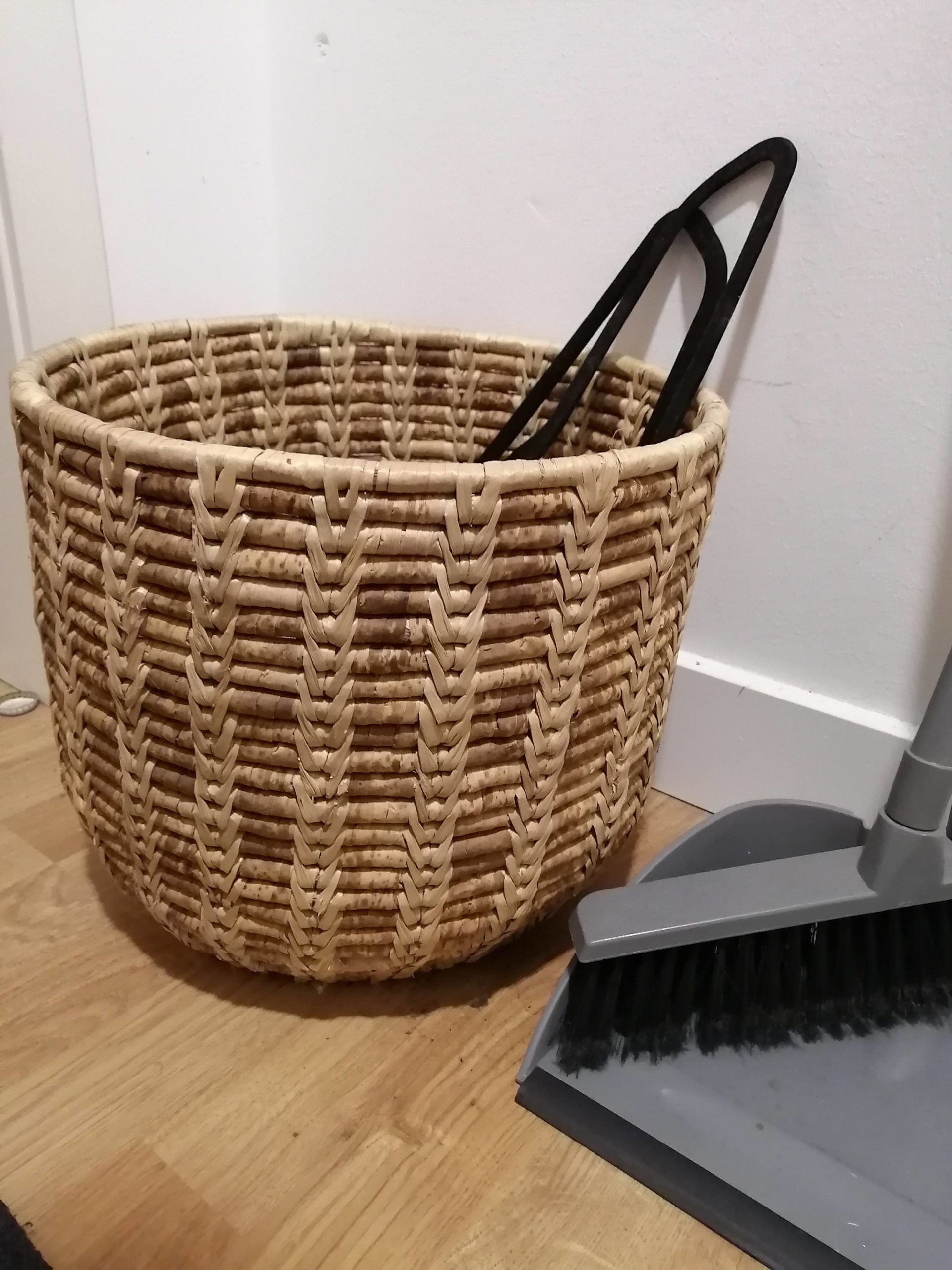 A wicker basket and broom