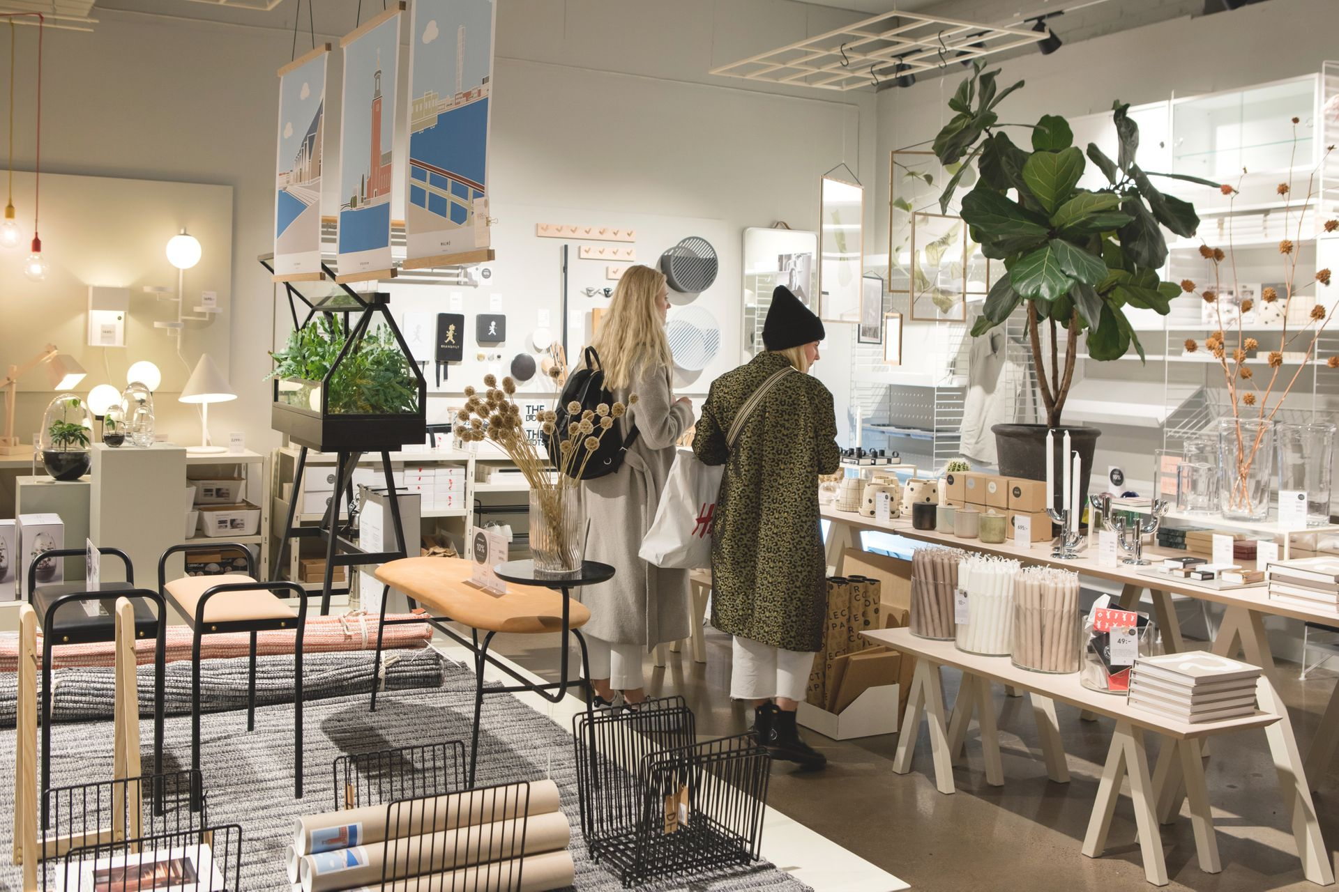 Two women are shopping in an interior design shop with a lot of Scandinavian design items.